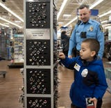 The 15th Annual Shop with a Cop event in Lansing.