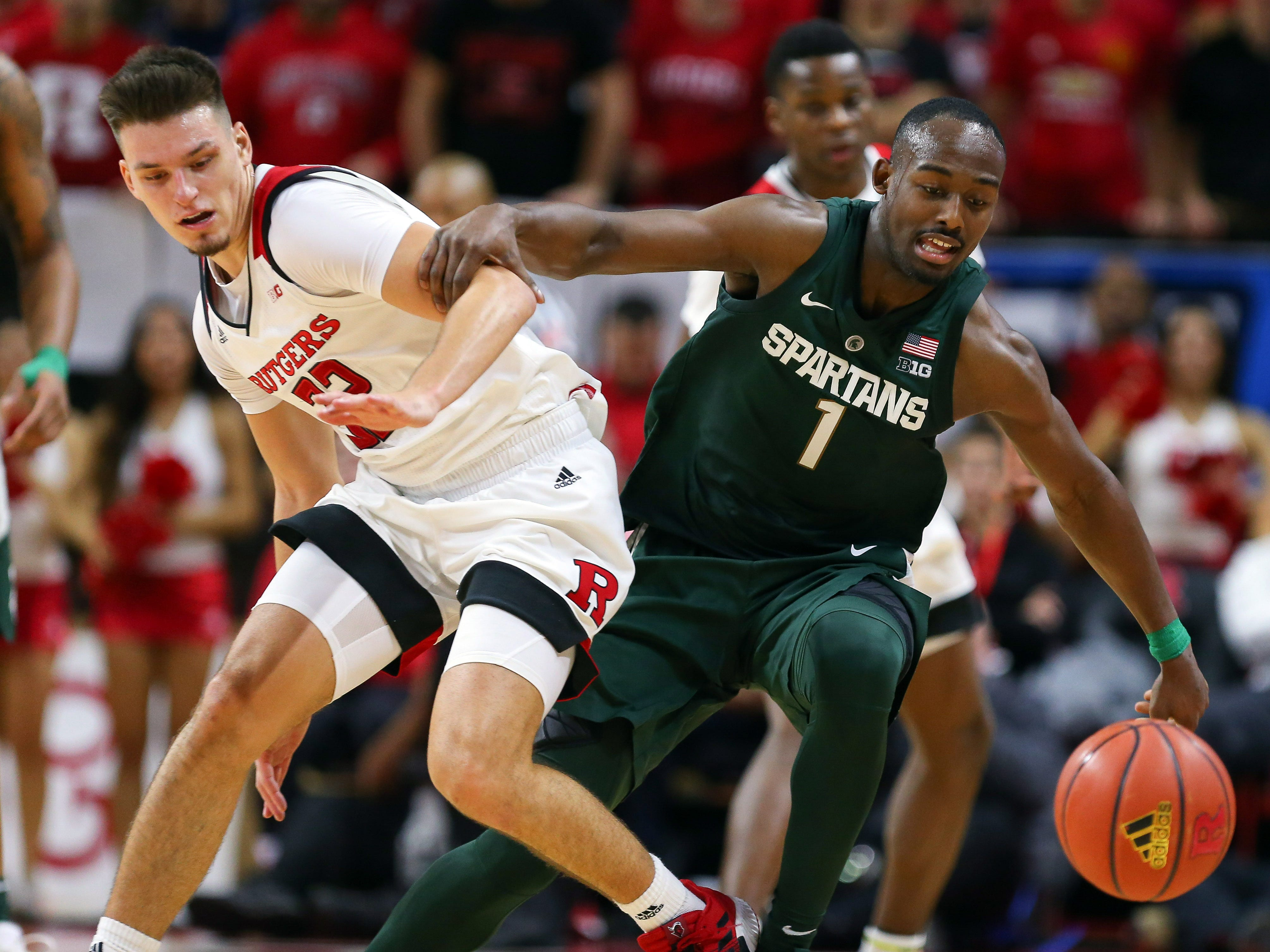 Michigan State Spartans guard Joshua Langford (1) chases a loose ball against Rutgers Scarlet Knights guard Peter Kiss (32) during the second half at Rutgers Athletic Center (RAC).