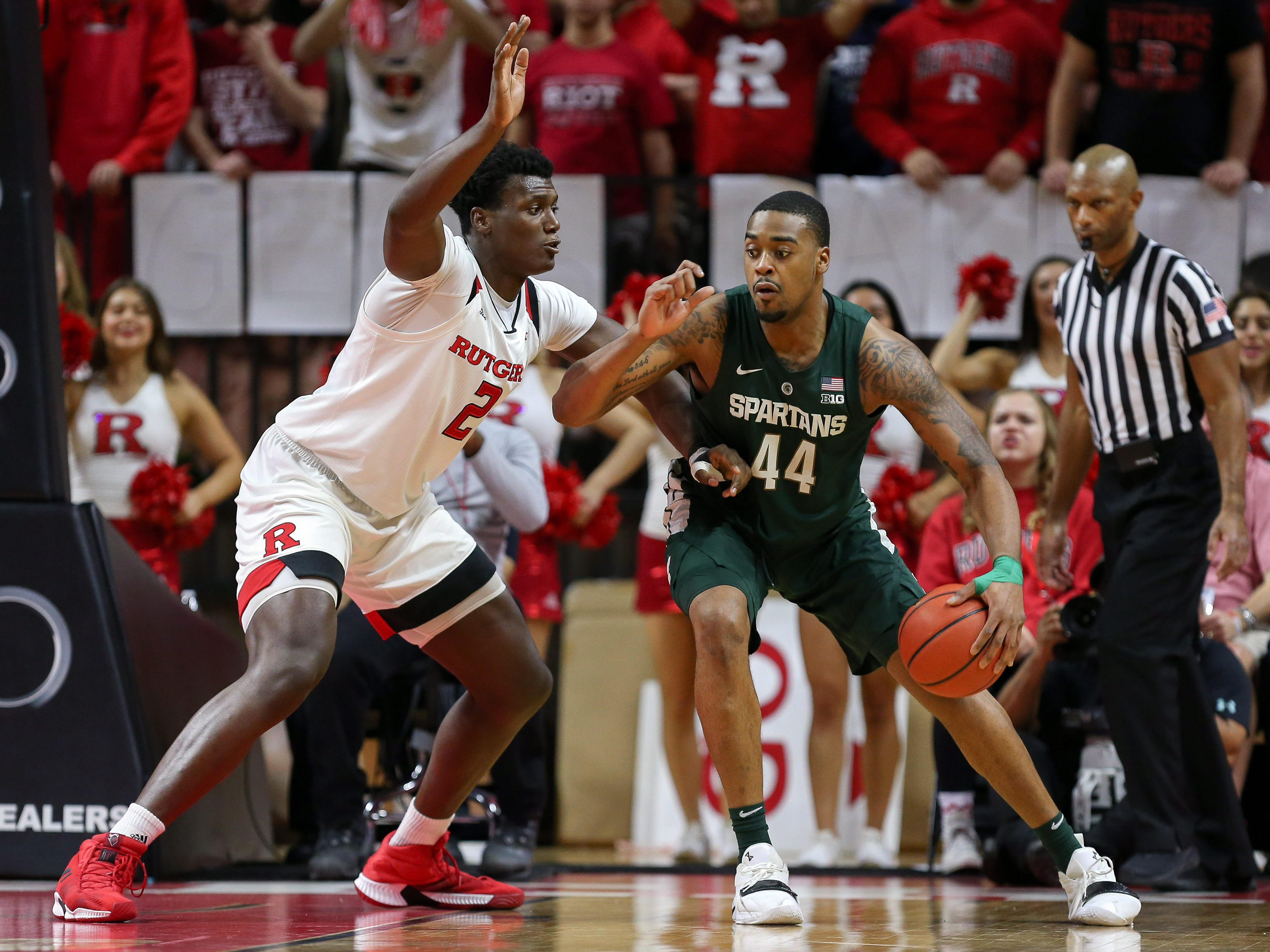 Michigan State Spartans forward Nick Ward (44) posts up on Rutgers Scarlet Knights center Shaquille Doorson (2) during the second half at Rutgers Athletic Center (RAC).