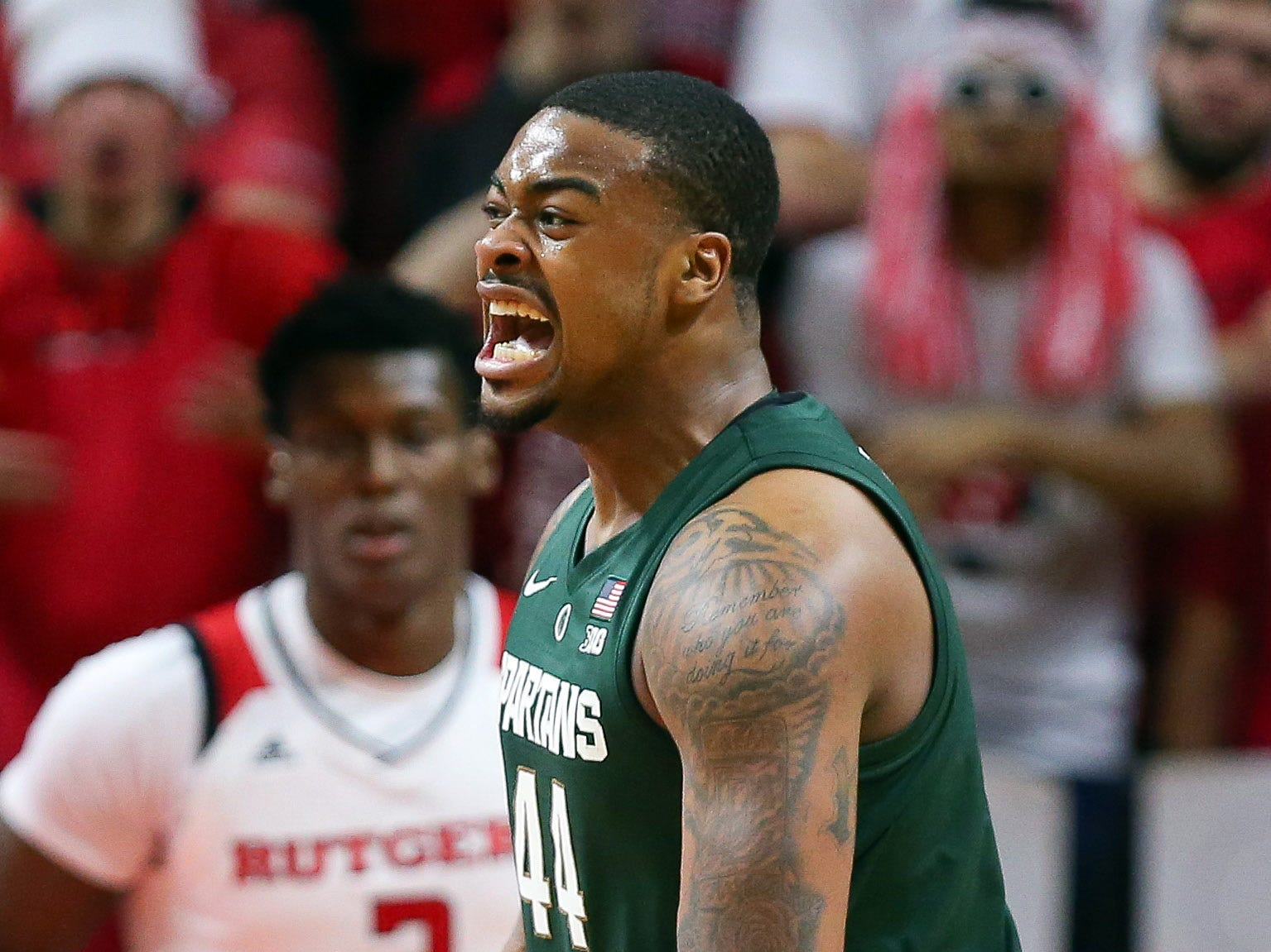 Michigan State Spartans forward Nick Ward (44) celebrates a basket in front of Rutgers Scarlet Knights center Shaquille Doorson (2) during the second half at Rutgers Athletic Center (RAC).