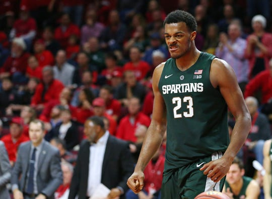 Xavier Tillman #23 of the Michigan State Spartans reacts after a basket against the Rutgers Scarlet Knights during the second half of a college basketball game at the Rutgers Athletic Center on November 30, 2018 in Piscataway, New Jersey. Michigan State defeated Rutgers 78-67.