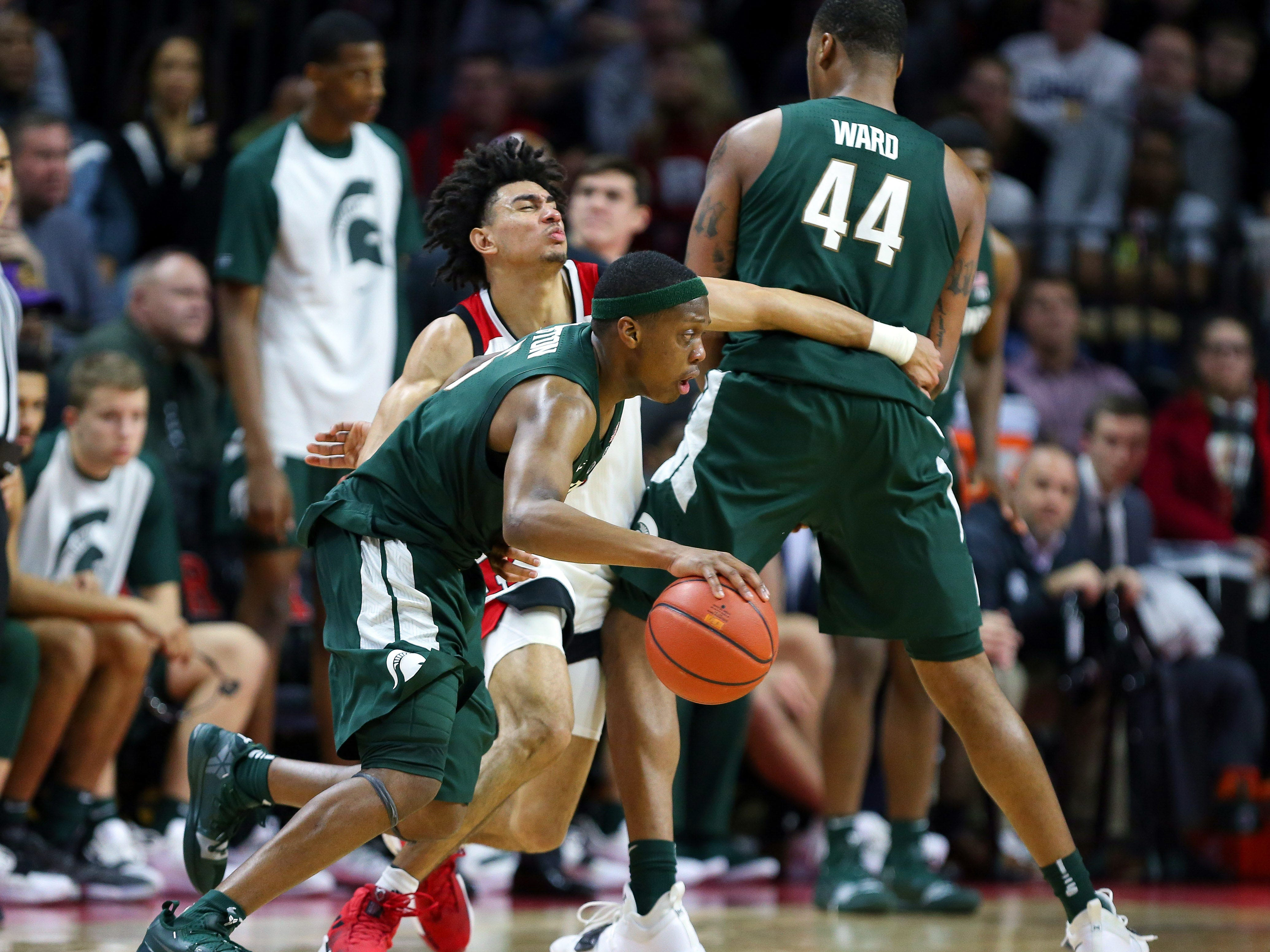 Rutgers Scarlet Knights guard Geo Baker (0) is screened by Michigan State Spartans forward Nick Ward (44) as guard Cassius Winston (5) dribbles during the second half at Rutgers Athletic Center (RAC).