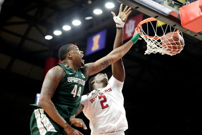 Michigan State forward Nick Ward (44) dunks against Rutgers center Shaquille Doorson (2) during the second half of an NCAA college basketball game, Friday, Nov. 30, 2018, in Piscataway, N.J.