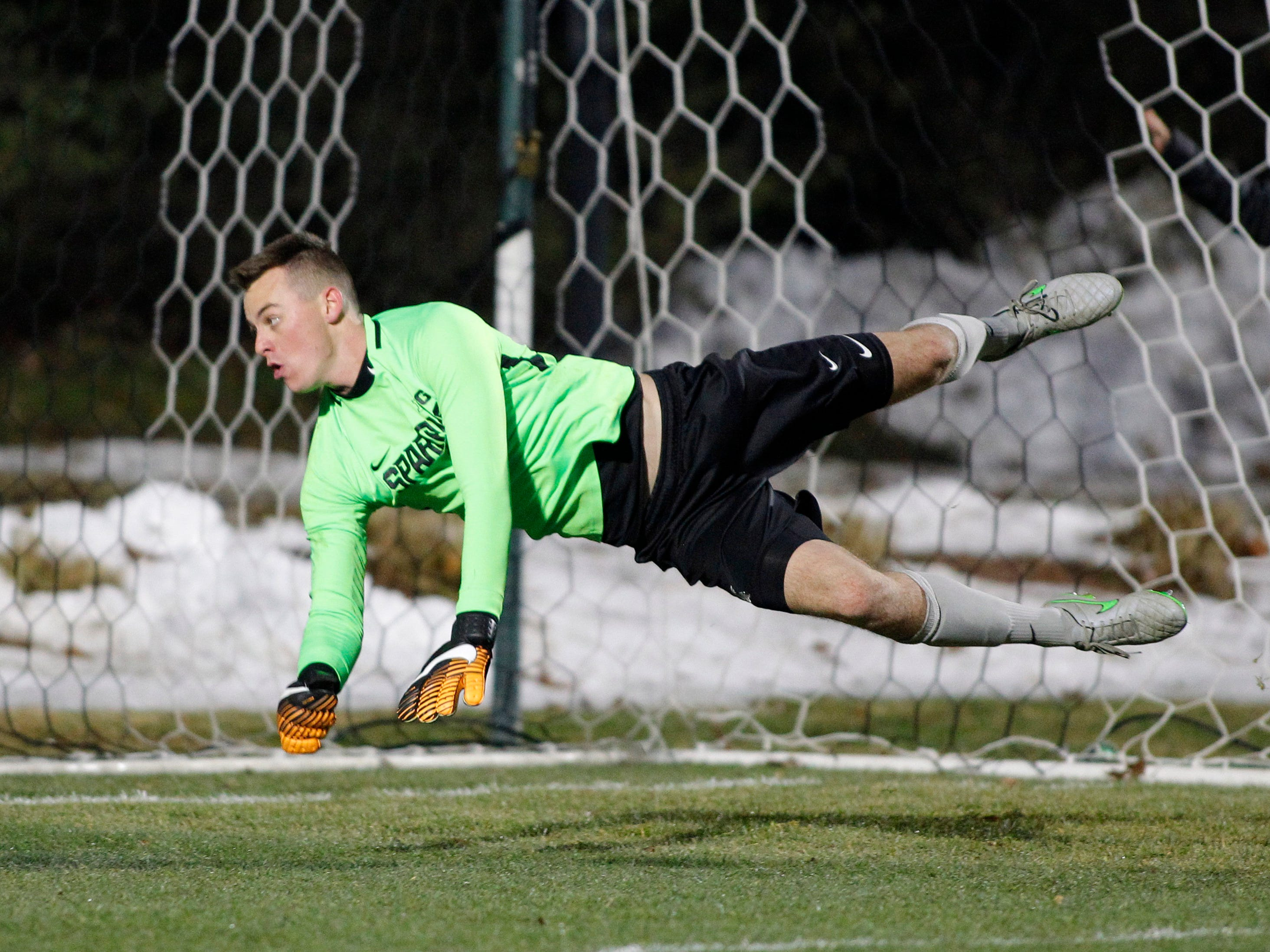 Michigan State goalkeeper Jimmy Hague dives for the ball against James Madison, Saturday, Dec. 1, 2018, in East Lansing, Mich.