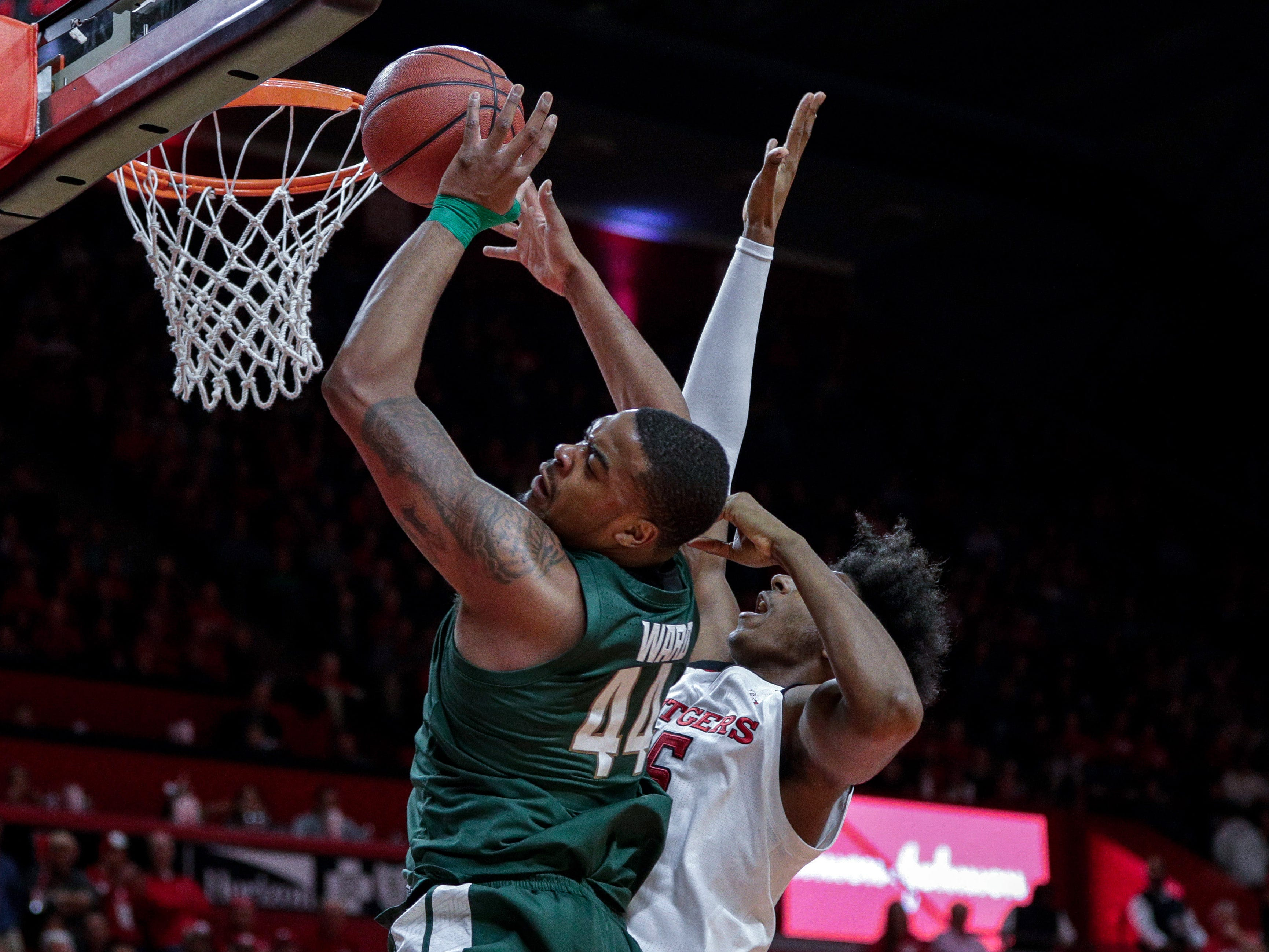 Michigan State Spartans forward Nick Ward (44) drives to the basket as Rutgers Scarlet Knights center Myles Johnson (15) defends during the first half at Rutgers Athletic Center (RAC).
