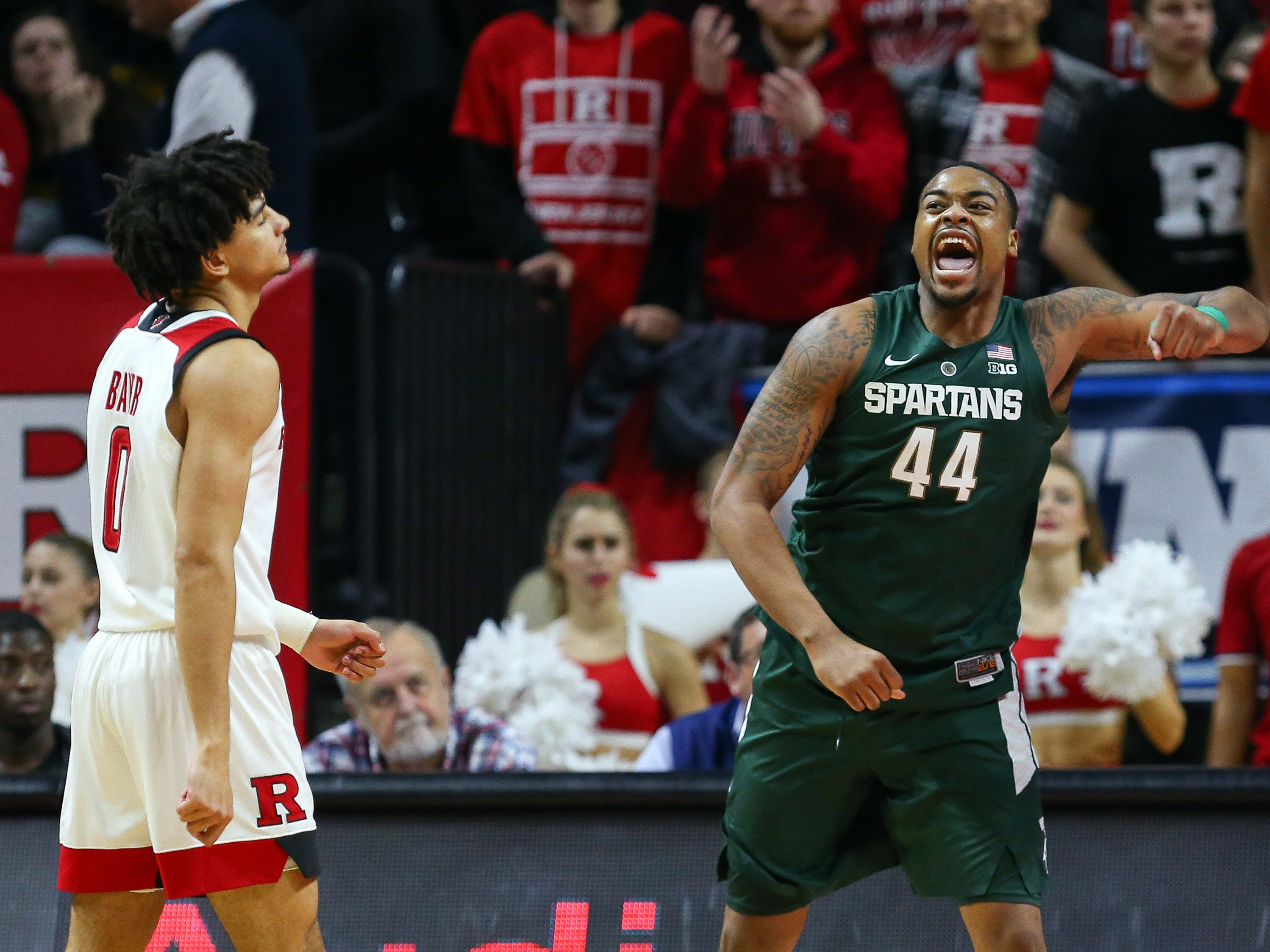 Michigan State Spartans forward Nick Ward (44) celebrates a basket in front of Rutgers Scarlet Knights guard Geo Baker (0) during the second half at Rutgers Athletic Center (RAC).