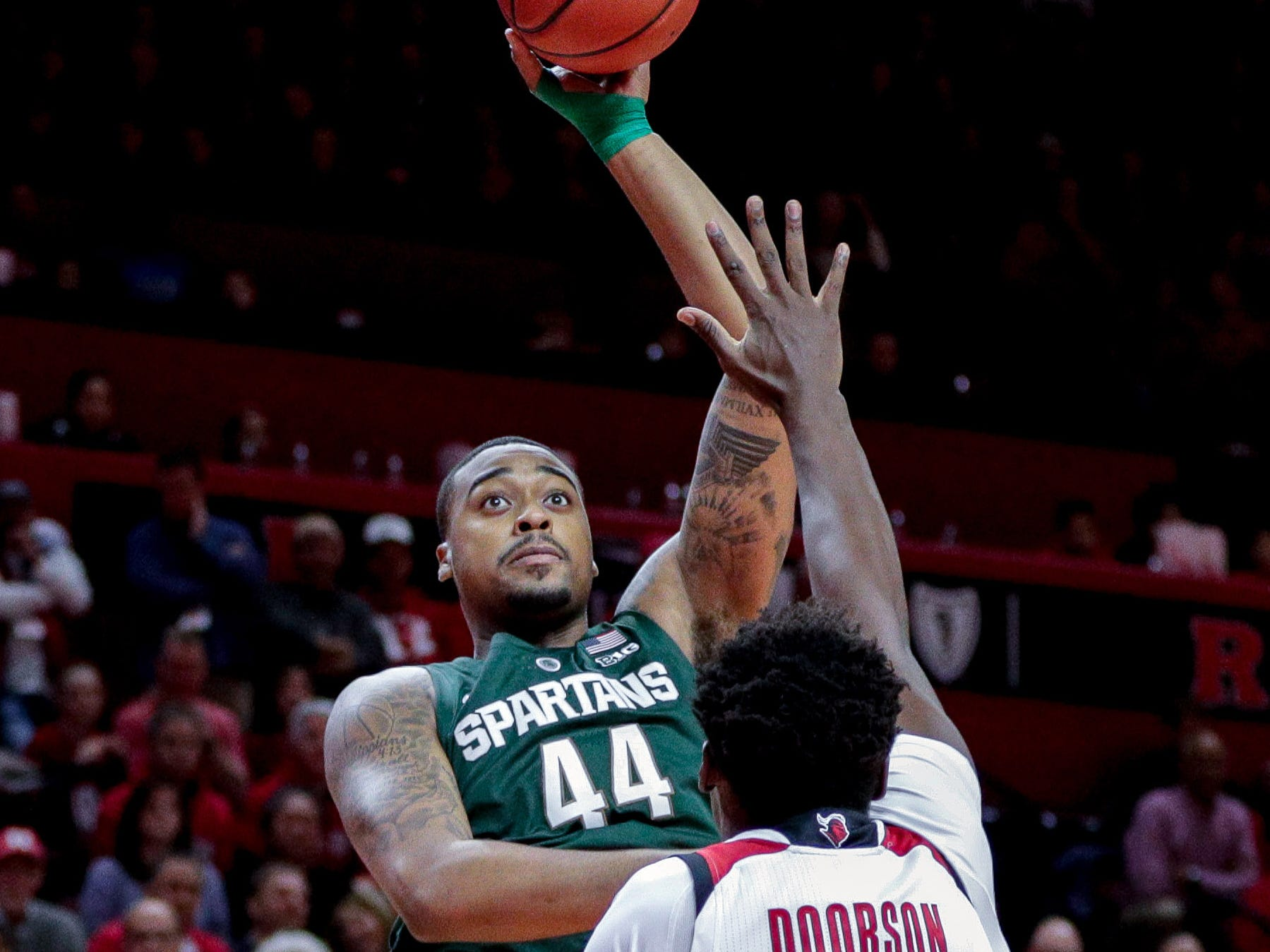 Michigan State Spartans forward Nick Ward (44) shorts the ball over Rutgers Scarlet Knights center Shaquille Doorson (2) during the first half at Rutgers Athletic Center (RAC).