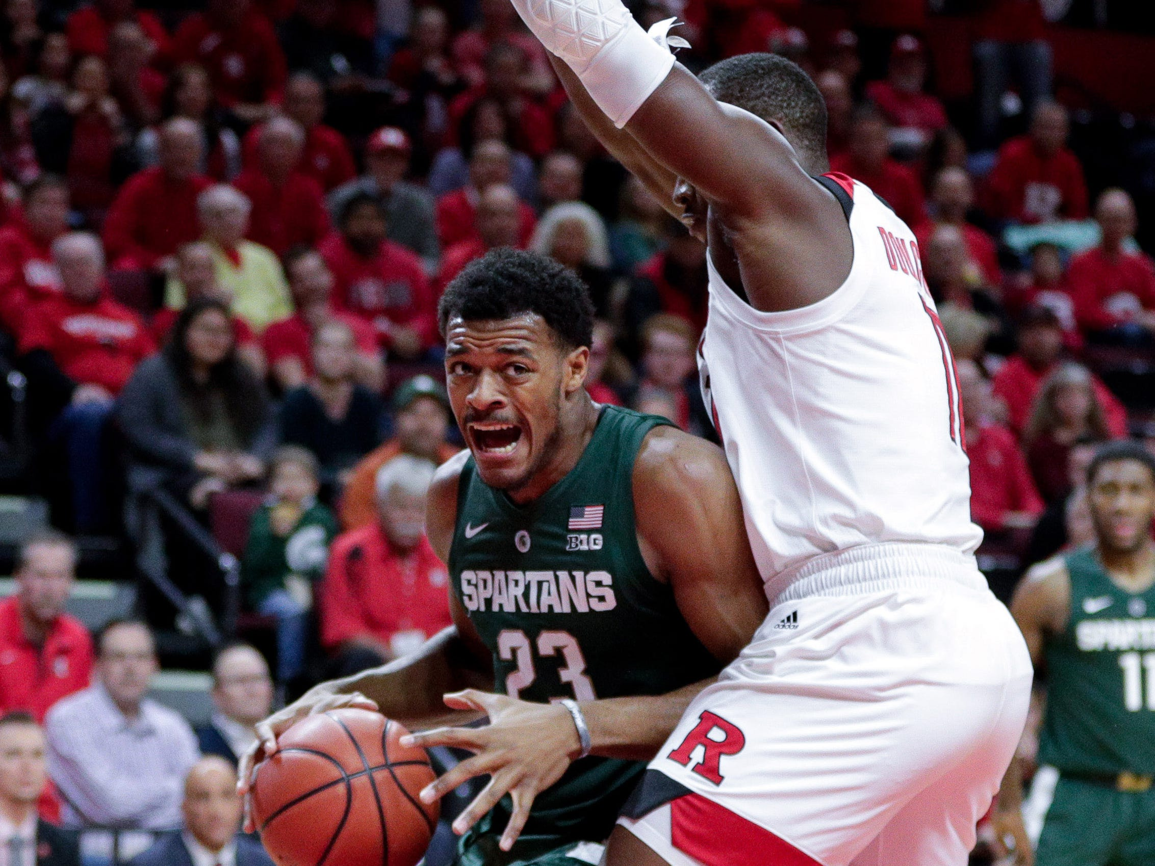 Michigan State Spartans forward Xavier Tillman (23) drives to the basket as Rutgers Scarlet Knights forward Mamadou Doucoure (11) defends during the first half at Rutgers Athletic Center (RAC).