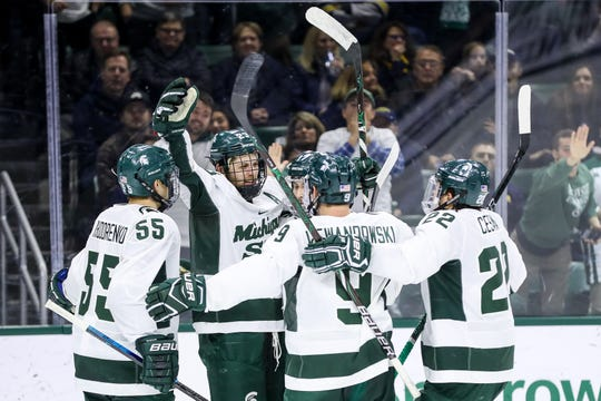 Michigan State senior forward Cody Milan celebrates his third-period power-play goal against Michigan. It was Milan's second goal of the season, and the Spartans defeated the Wolverines 4-3 on Friday.