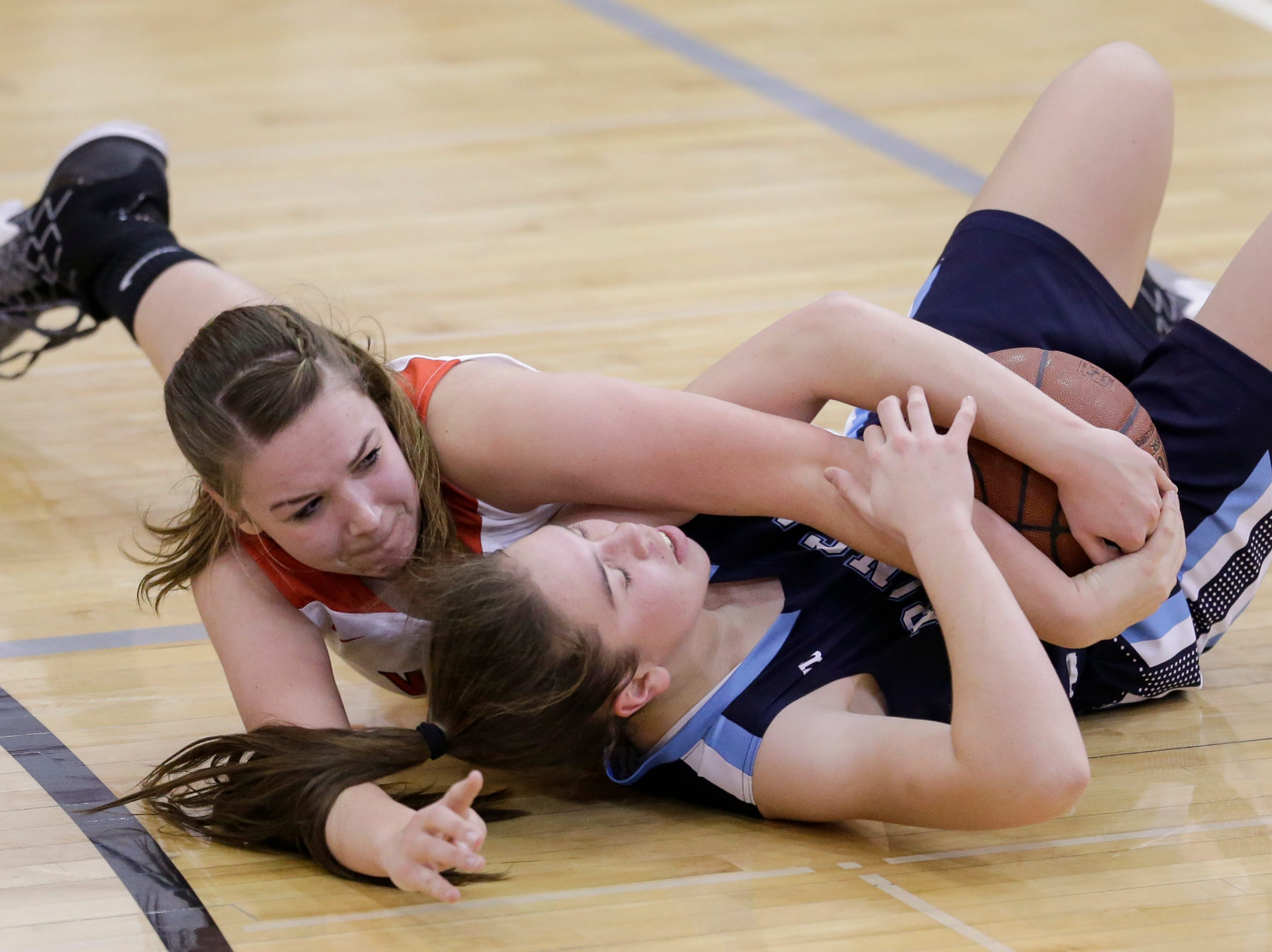 Valders' Allison Schneider (25) wrestles the ball from Roncalli's Maya Lusk (3) during an Eastern Wisconsin Conference game at Valders High School Friday, November 30, 2018, in Valders, Wis. Joshua Clark/USA TODAY NETWORK-Wisconsin