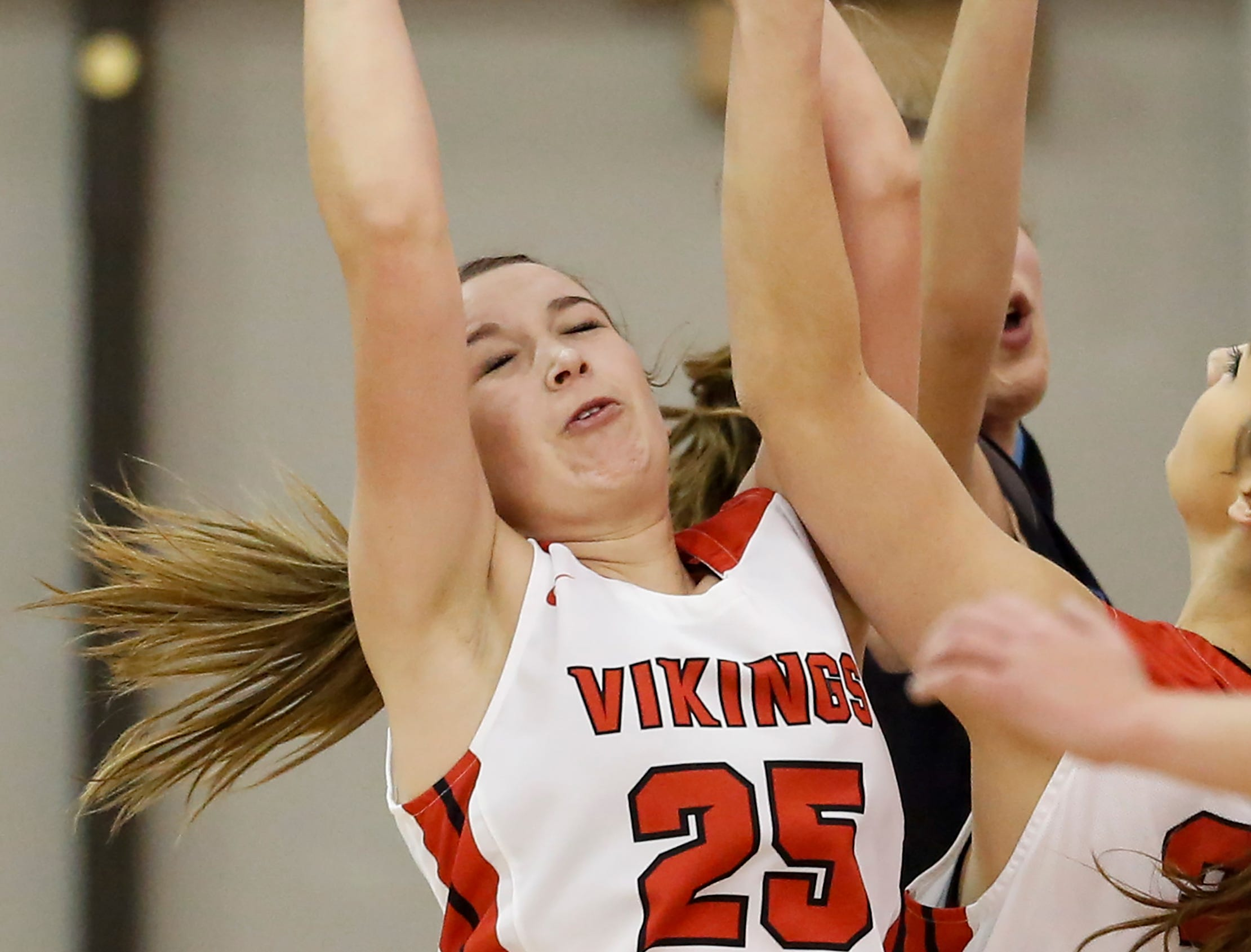 Valders' Allison Schneider (25) rebounds against Roncalli in an Eastern Wisconsin Conference game at Valders High School Friday, November 30, 2018, in Valders, Wis. Joshua Clark/USA TODAY NETWORK-Wisconsin