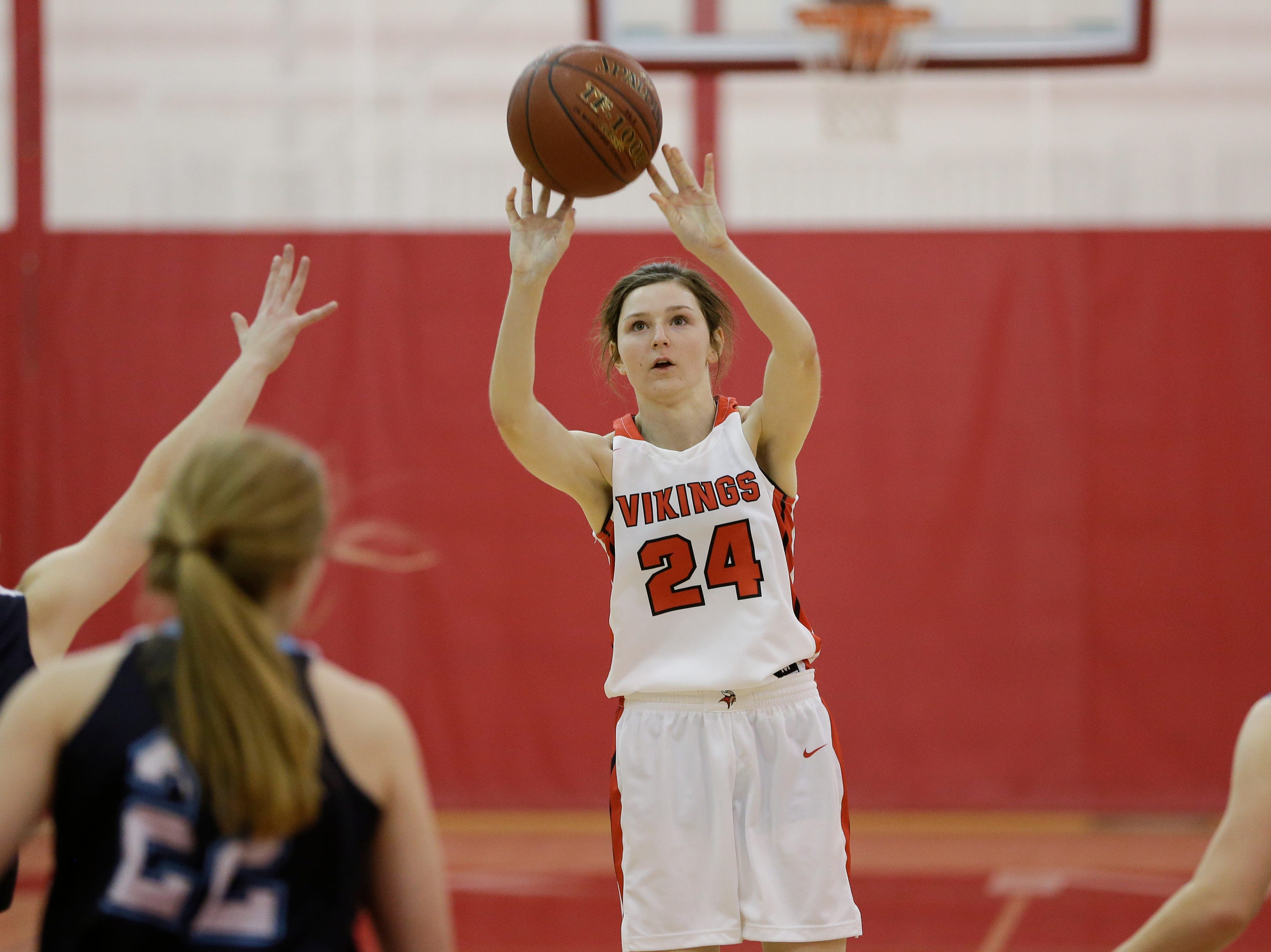 Valders' Emma Wagner shoots against Roncalli during an Eastern Wisconsin Conference game at Valders High School Friday, November 30, 2018, in Valders, Wis. Joshua Clark/USA TODAY NETWORK-Wisconsin