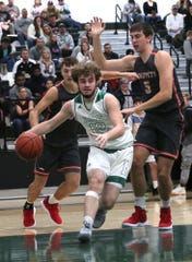 Madison's Tyler Tackett drives to the basket during Friday's home game with Shelby.