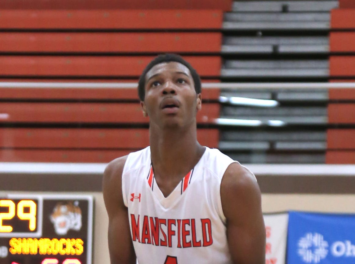 Mansfield Senior's Dontavious Burtin makes a shot at the free throw line while playing against Dublin Coffman on Friday.