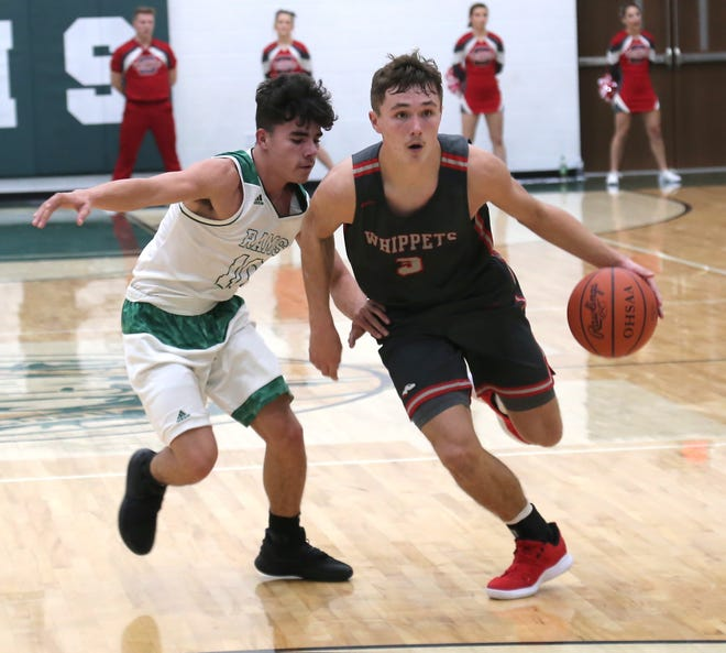 Shelby's Uriah Schwemley dribbles the ball against Madison's Steven Williams during opening night of high school boys basketball. Schwemley has his Whippets undefeated and the No. 1 team in the Richland County Boys Basketball Power Poll.
