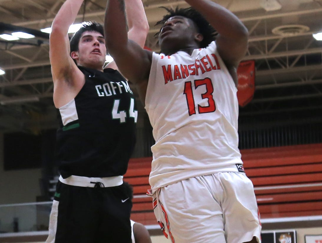 Mansfield Senior's Quan Hilory attempts a jump shot while playing against Dublin Coffman on Friday.