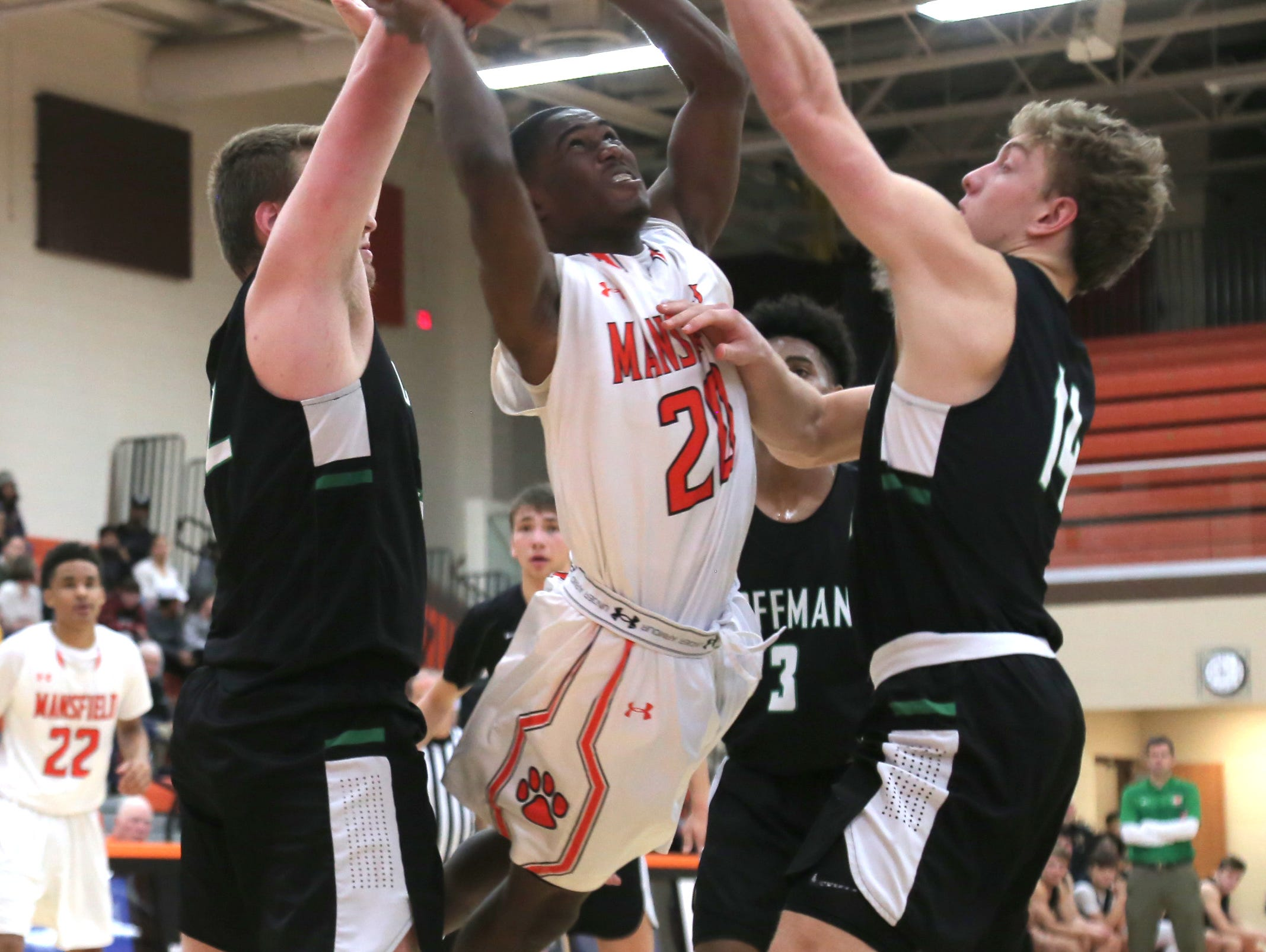 Mansfield Senior's Tavion Harris attempts a jump shot while playing against Dublin Coffman on Friday.