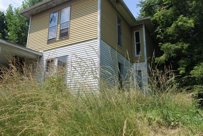 The grass stood about three feet tall at this Marion house in June.