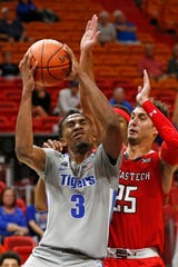 Texas Tech's Davide Moretti defends against Memphis guard Jeremiah Martin on Saturday.