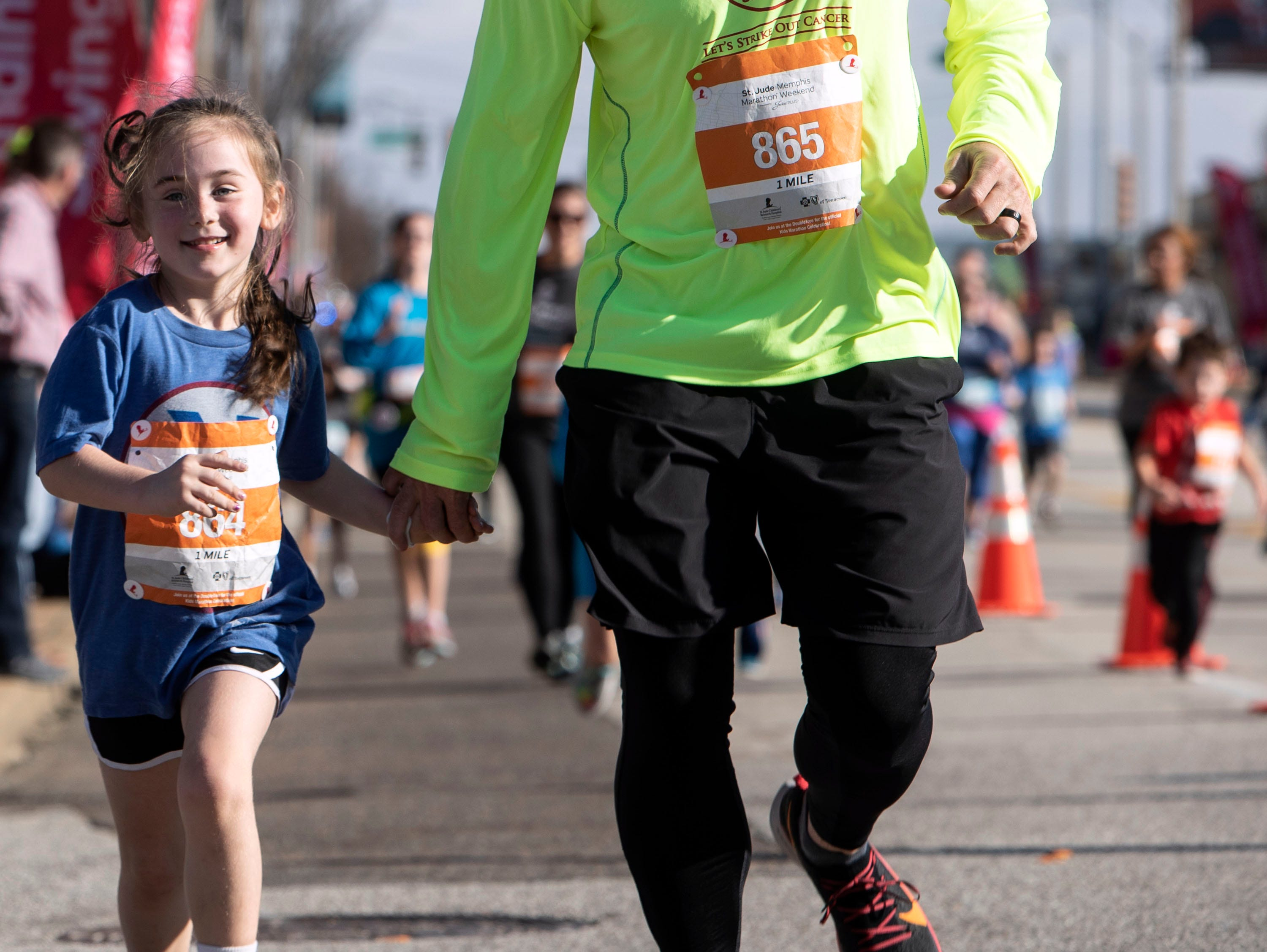 Young runners make their way downtown to the finish line  during the St. Jude Memphis Marathon on Saturday, Dec. 1, 2018.