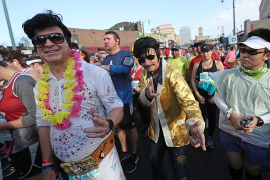 Richard Wendt, left, and Rick Ingerson, two Floridians who regularly run races together, dressed as Elvis Presley for the St. Jude Memphis Marathon on Saturday.
