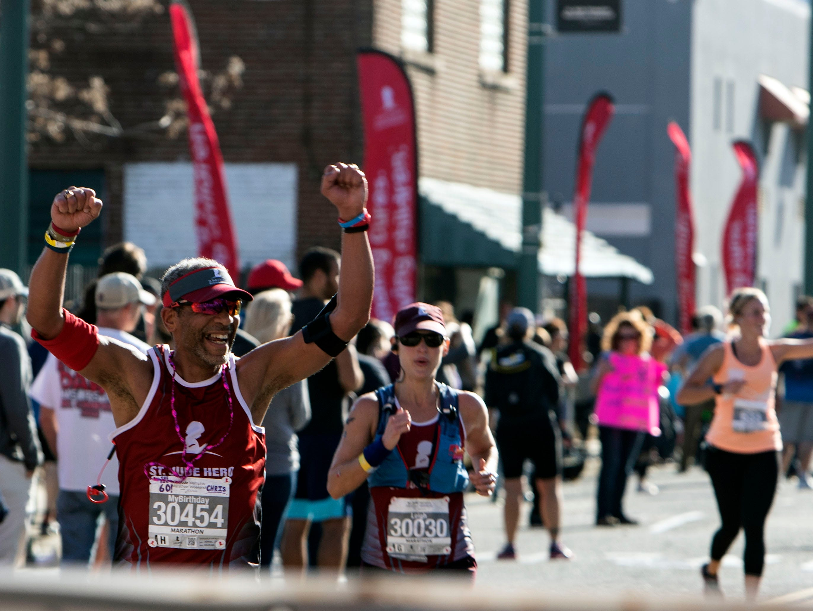 Runners make their way downtown to the finish line  during the St. Jude Memphis Marathon on Saturday, Dec. 1, 2018.