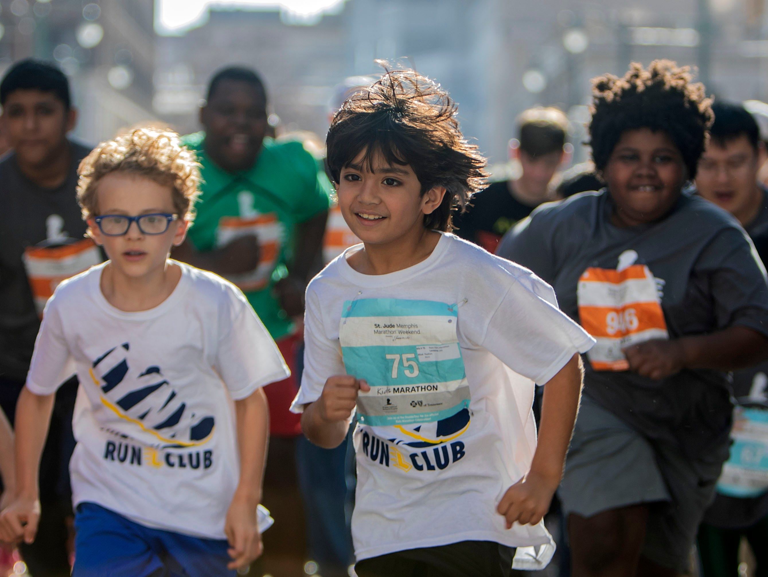 Young runners make their way  Downtown   for the St. Jude Memphis Marathon on Saturday, Dec. 1, 2018.