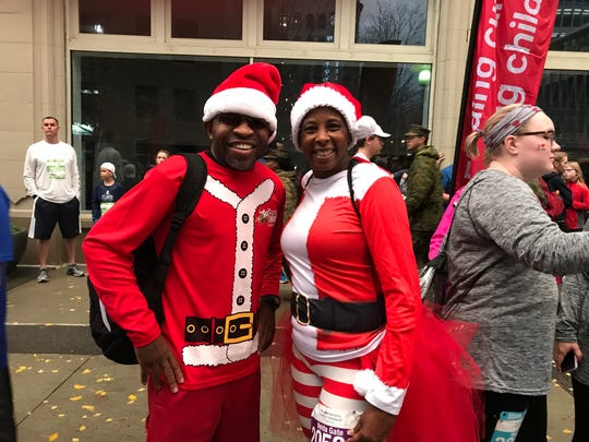 Julian Williams (left) and Velda Gates (right) ran in the St. Jude Memphis Marathon while wearing Santa Claus costumes.