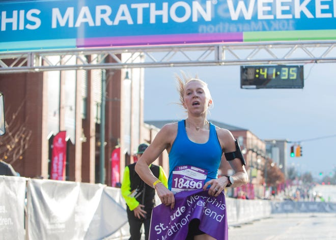 Joanne Roberts is the first women to complete  the 2018 St. Jude Memphis Marathon race on Saturday, Dec. 1, 2018.