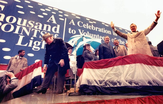 """November 22, 1989 - President George H.W. Bush waves goodbye to the crowd gathered on the lawn of The Commercial Appeal. President Bush took the stage with Governor Ned McWherter and volunteers who were celebrated in the newspaper's """"Thousand Points of Light"""" series."""