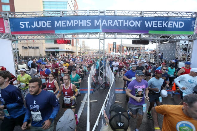 Runners make their way through downtown for the St. Jude Memphis Marathon on Saturday, Dec. 1, 2018.