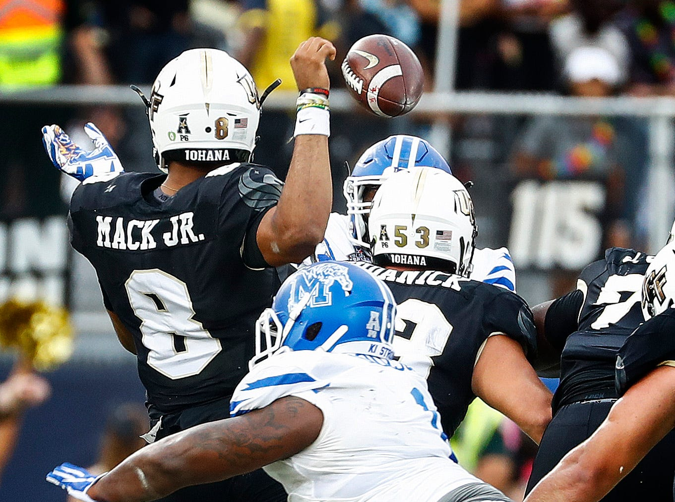 Memphis defender O'Bryan Goodson (bottom) hits UCF quarterback Darriel Mack Jr. (top) causing a fumble, that the Tigers recovered during action at the AAC Championship Football game Saturday, December 1, 2018 in Orlando.