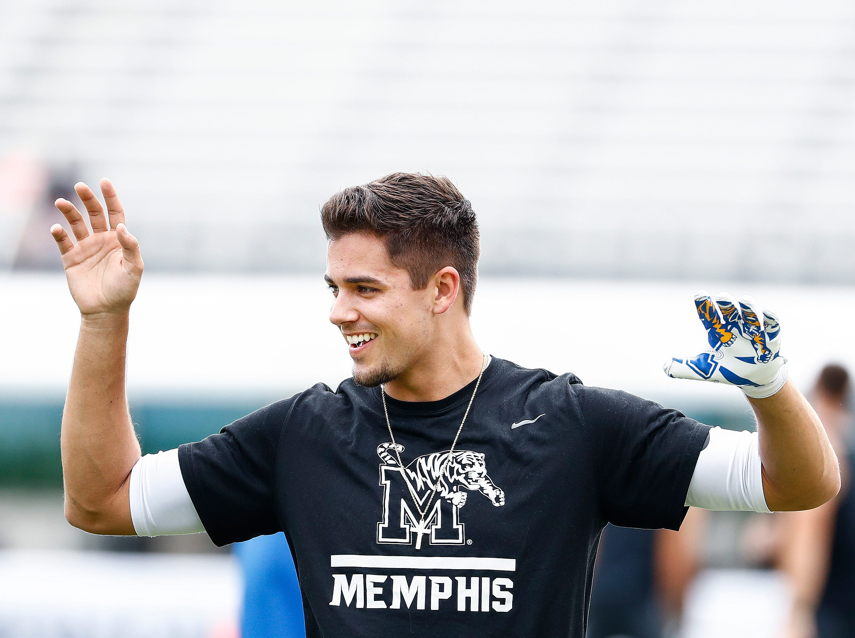 Memphis starting quarterback Brady White during warmups before taking on UCF in the AAC Championship Football game Saturday, December 1, 2018 in Orlando.