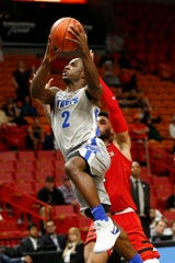 Memphis guard Alex Lomax (2) drives to the basket past Texas Tech guard Brandone Francis during the second half of an NCAA college basketball game at the Air Force Reserve Hoophall Miami Invitational in Miami, Saturday, Dec. 1, 2018.