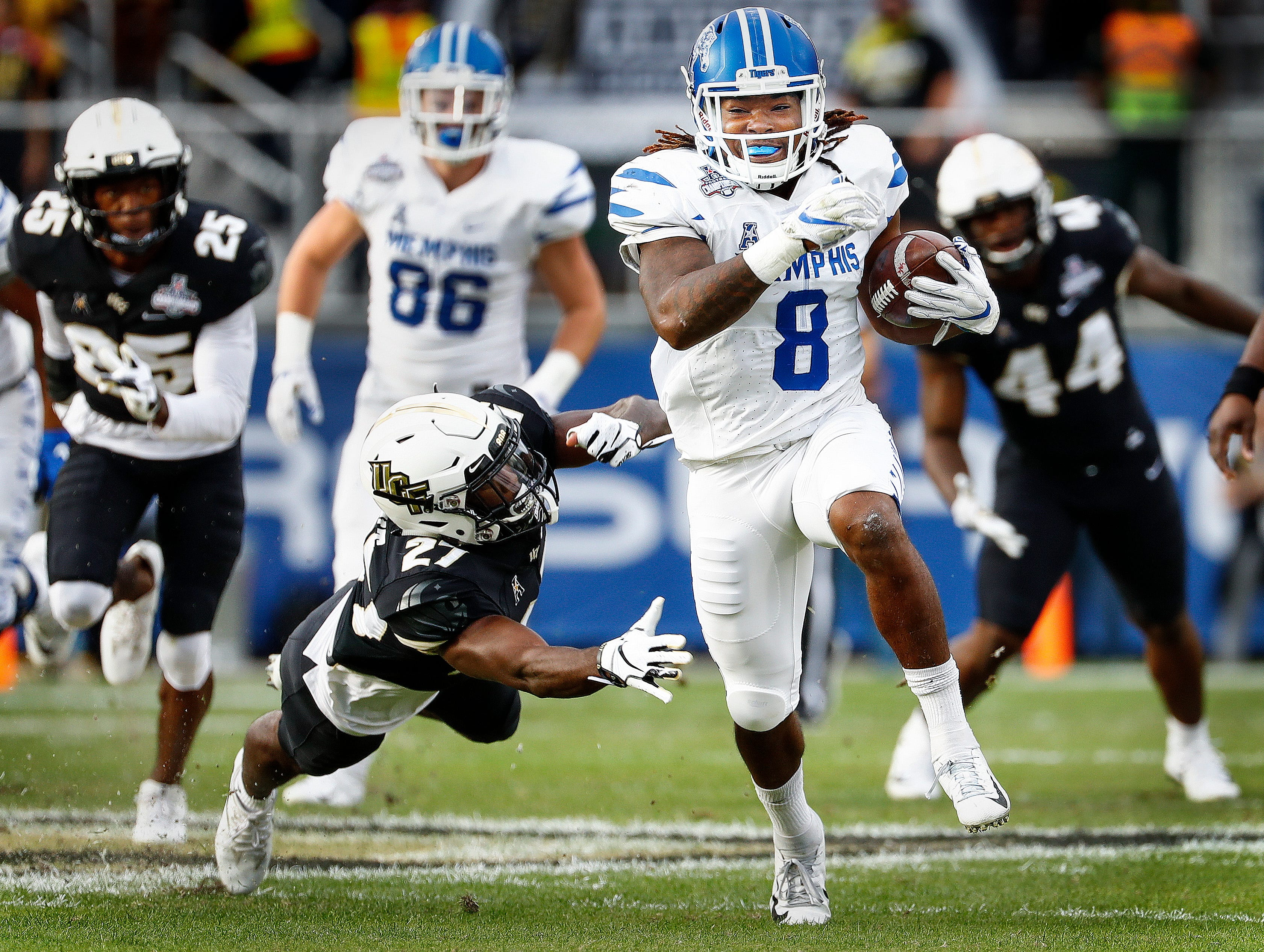 Memphis running back Darrell Henderson (right) scrambles past the UCF defense for a touchdown during action at the AAC Championship Football game Saturday, December 1, 2018 in Orlando.