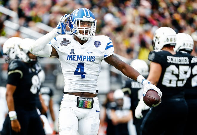 Memphis defender Josh Perry (middle) celebrates a fumble recovery against UCF during action at the AAC Championship Football game Saturday, December 1, 2018 in Orlando.