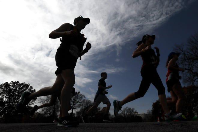 Runners make their way through Overton Park for the St. Jude Memphis Marathon on Saturday, Dec. 1, 2018.