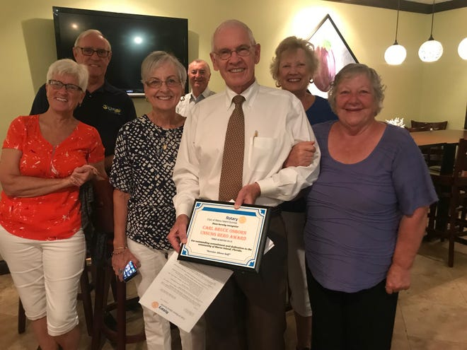 "The Rotary Club of Marco Island Sunrise presented its Unsung Hero Award for Third Quarter to Carl ""Bruce"" Osborn. Osborn was awarded for his services as a volunteer with Avow Hospice during a Nov. 27 event."