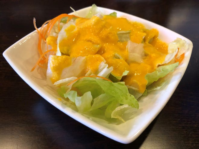 A side salad with ginger dressing from Saki Japanese Kitchen, East Naples.