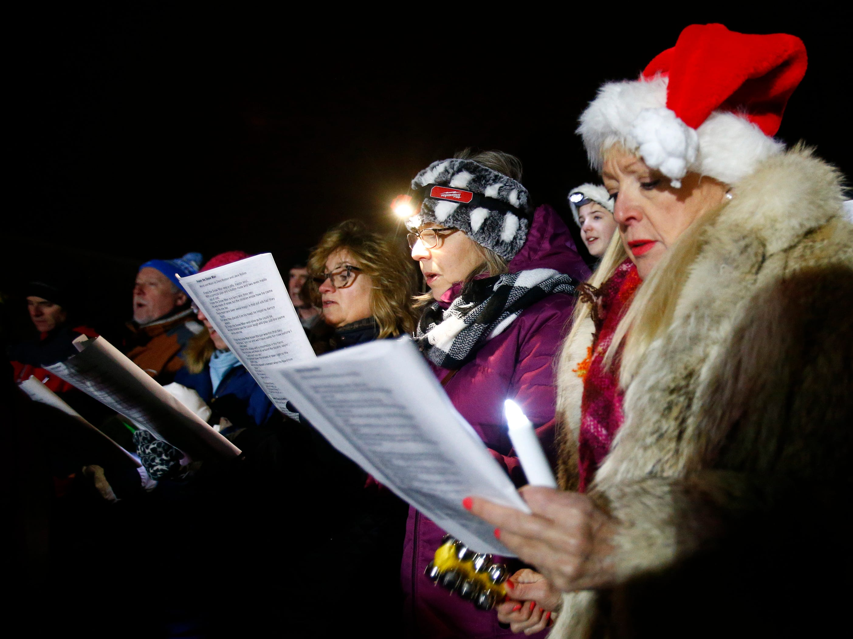 Members of the St. Charles Choir sing seasonal music during the Hartland Lights on Nov. 30.