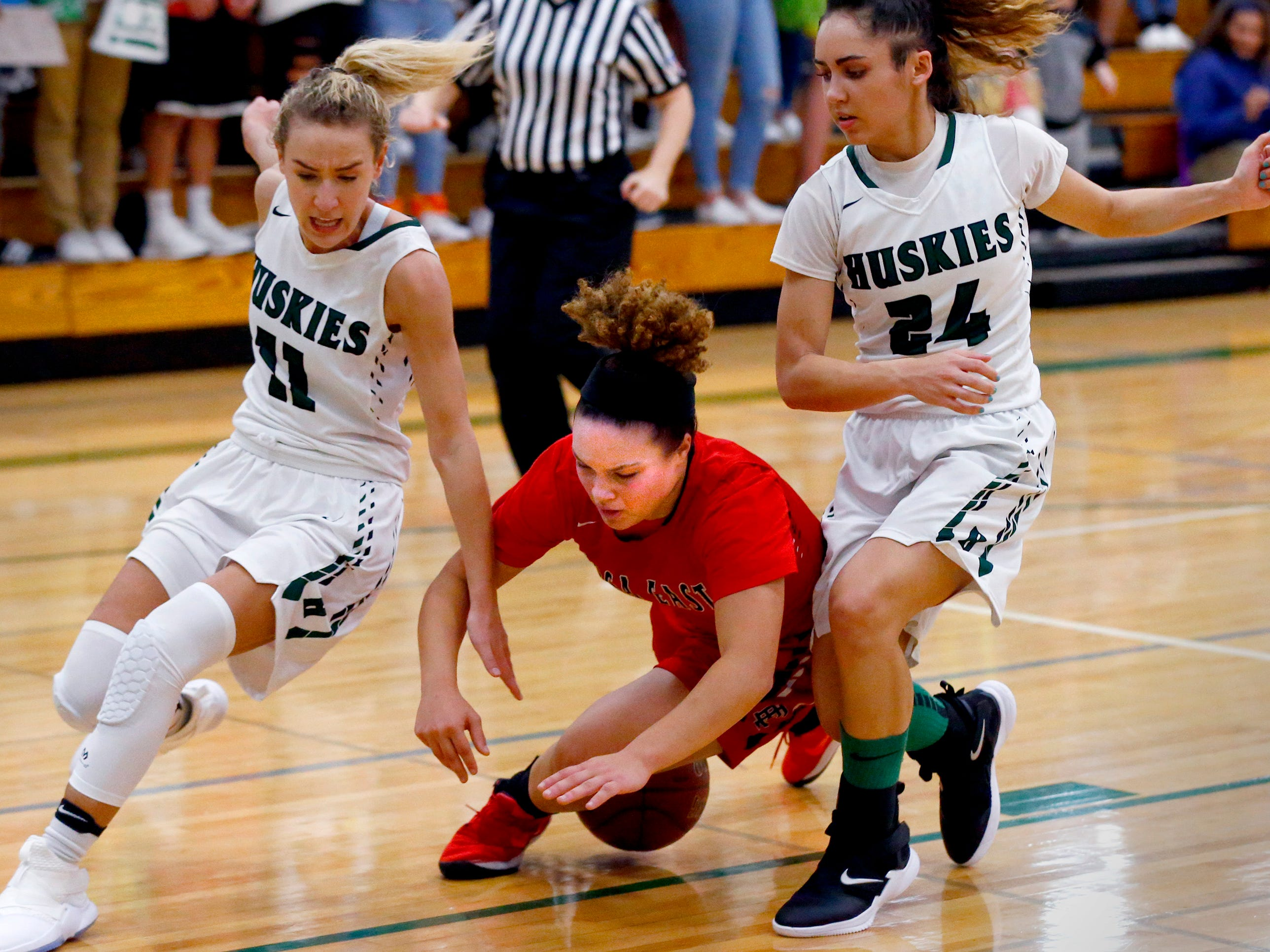 Wauwatosa East's Ashlyn Yow trips up between West Allis Hale's Calie Walk (left) an Natalia Leguizamon at Hale on Nov. 30.
