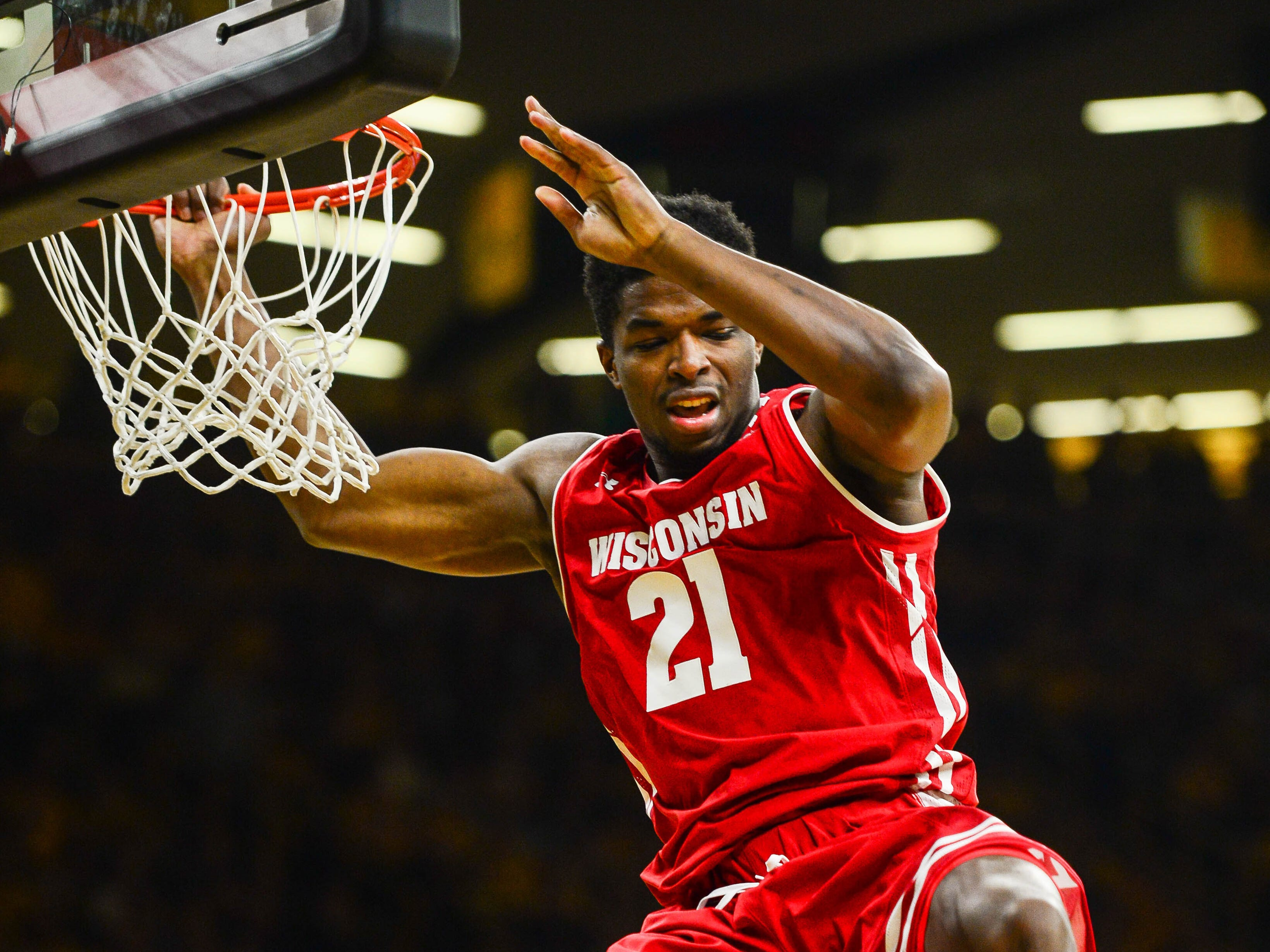 Badgers guard Khalil Iverson starts to fall back to the court after throwing down a dunk against the Hawkeyes on Friday night.