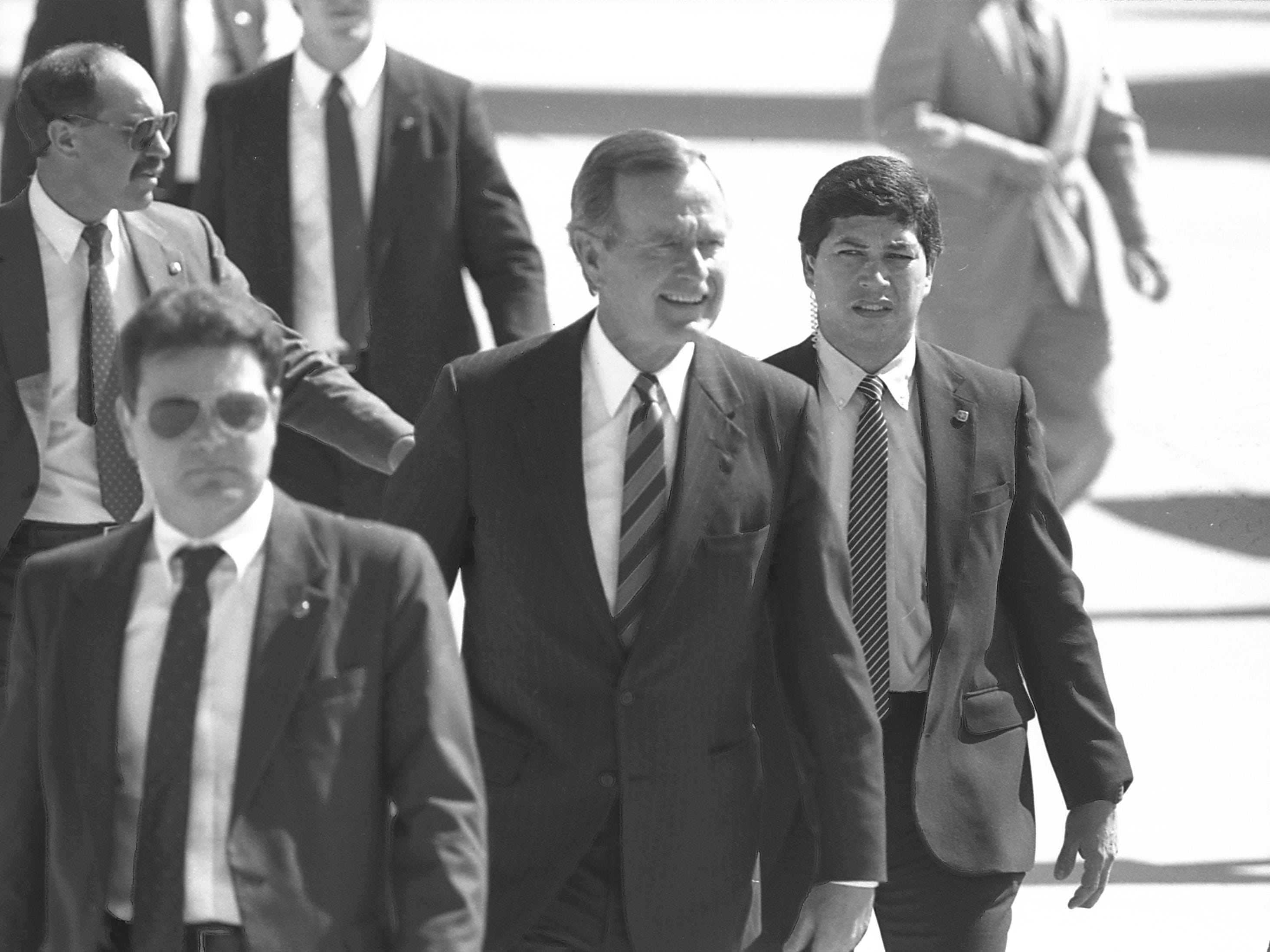 Vice President George H.W. Bush arrives  at Mitchell Field for a fundraising luncheon at the Performing Arts Center in 1987.