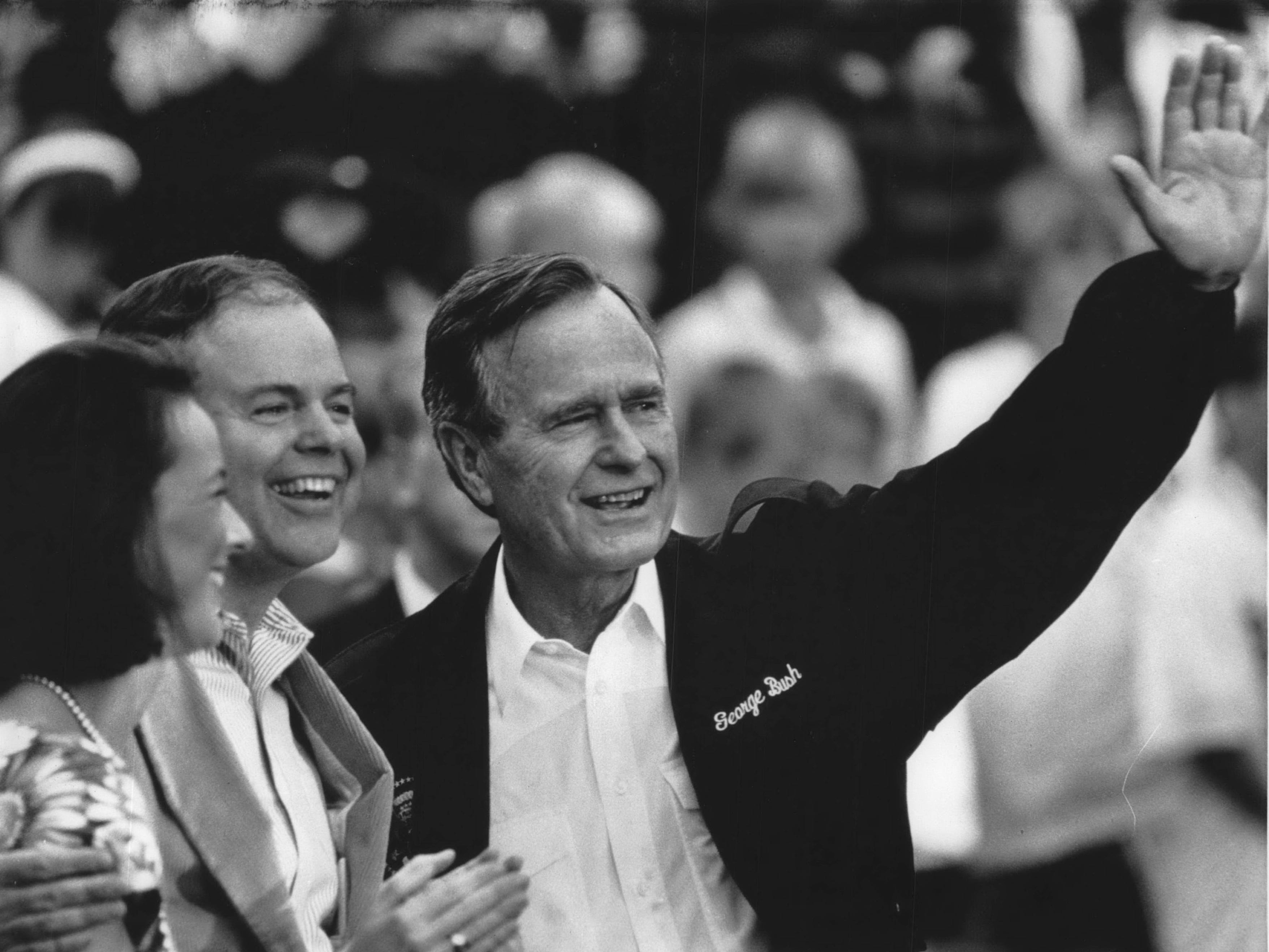 President George Bush greets the crowd with U.S. Sen. Bob Kasten (R-Wisconsin) and Kasten's wife, Eva, during a Waukesha County appearance in 1992.
