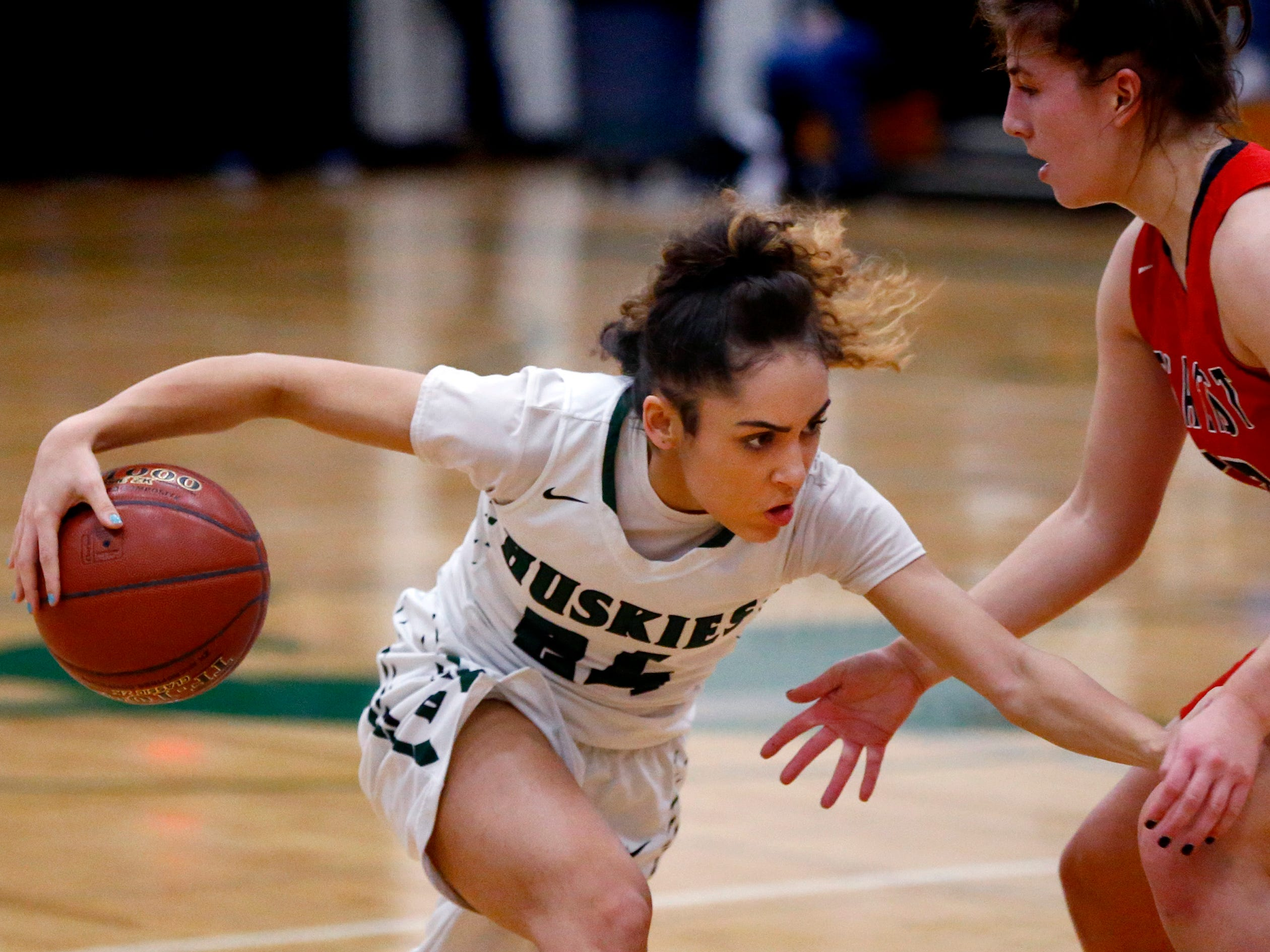 West Allis Hale's Natalia Leguizamon drives to the basket past Wauwatosa East's Sydney Halstead at Hale on Nov. 30.