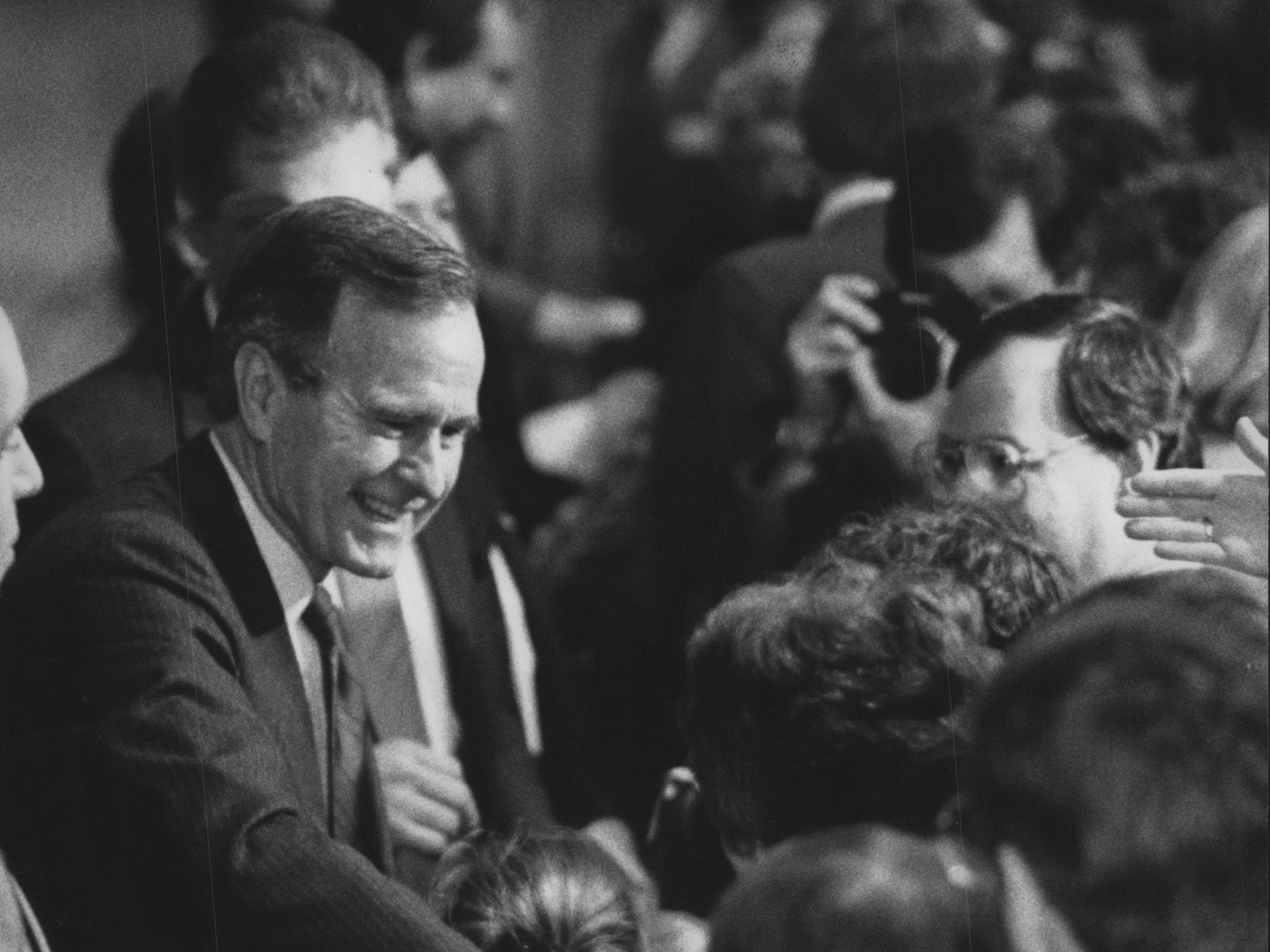 George Bush shakes hands during a stop in Cedarburg in the 1988 presidential campaign.