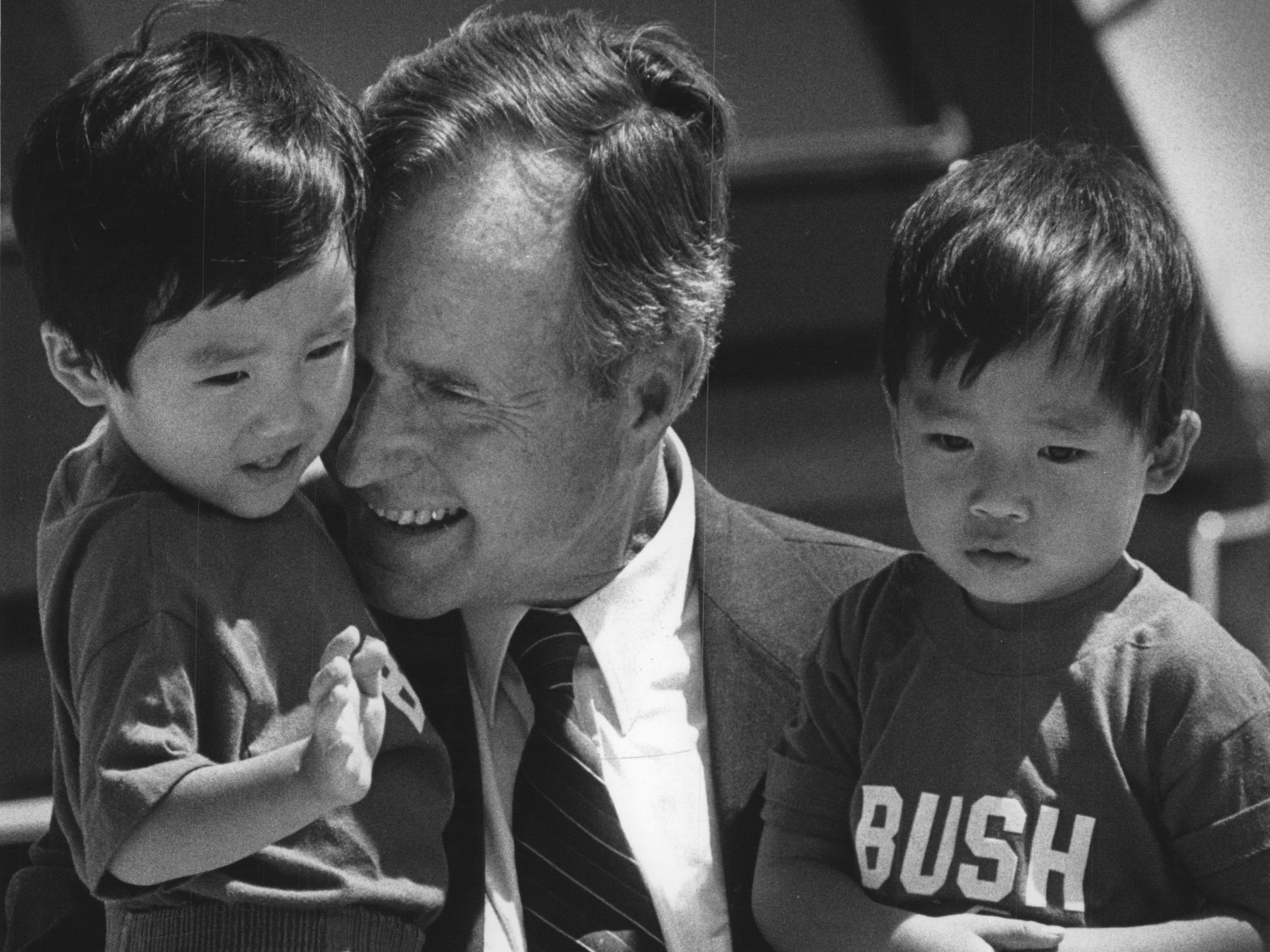 Vice President George Bush holds twins Christopher and Joshua Block, children of Janelle and Mark Block of New Berlin, before departing from Mitchell International Airport in 1988 after a five-hour campaign visit that included a stop at Festa Italiana.