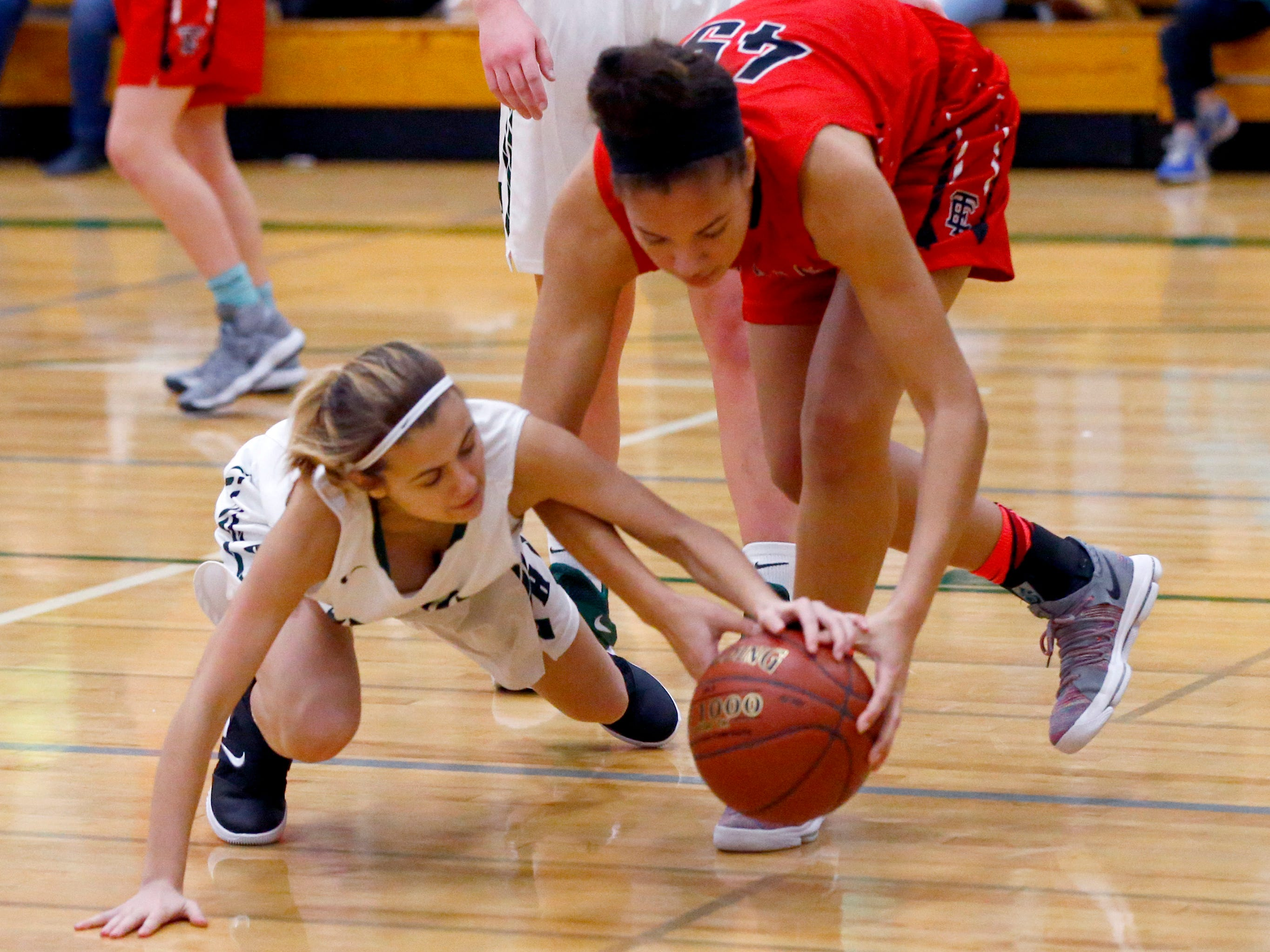 West Allis Hale's Tiffani Paulos and Wauwatosa East's Brooklyn Blackburn scramble for the ball at Hale on Nov. 30.