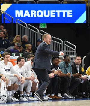 Marquette coach Steve Wojciechowski shouts instructions to his troops against Kansas State earlier this month.