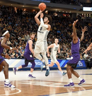 Marquette guard Markus Howard puts up a shot against Kansas State in a non-conference men's basketball game Saturday,